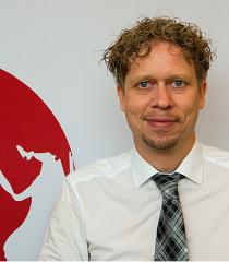 Dr. G. Kristian KAMPFER